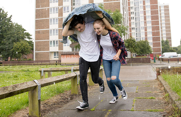 Couple running in the rain